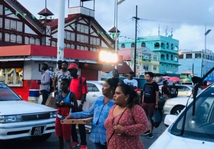 passers-by-who-stopped-to-listen-to-the-speakers-at-the-meeting-hosted-by-a-new-and-united-guyana-the-new-movement-and-the-liberty-and-justice-party