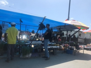A customer at a stall in the Mon Repos Market yesterday