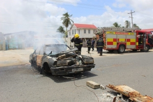 A torched car that was blocking the road