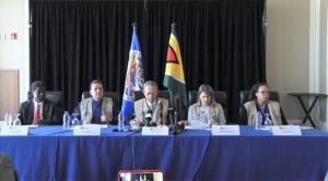 Chief of Mission of the OAS, Bruce Golding flanked by other OAS observers
