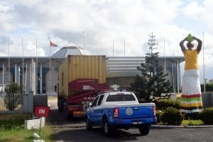 Container trucks with ballots arrive at the Arthur Chung Conference Center