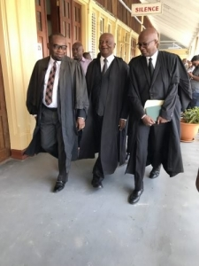 From left are attorneys Roysdale Forde, Neil Boston and Robin Hunte as they made their way to the Chief Justice's court yesterday