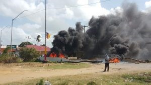 Protesters blocked and set fire to the roadway at Bath, West Coast Berbice.