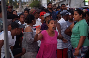 Residents of Mon Repos and supporters of the PPPC raging as they engage in a verbal exchange with supporters of the coalition