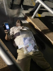 Robeson on lying on the ground after he refused to leave the Conference Center where the ballot boxes are being stored.