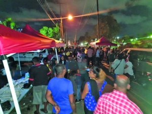 Scores of persons gathered on Cowan Street, Kingston, Georgetown overlooking the Guyana Elections Commission on Sunday evening