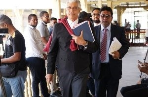 Trinidad's Senior Counsel, Douglas Mendes and Attorney-at-Law, Anil Nandlall proceeding to the courtroom on Sunday