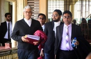 Trinidad's Senior Counsel Douglas Mendes and Attorney-at-Law Anil Nandlall proceeding to the courtroom on Tuesday
