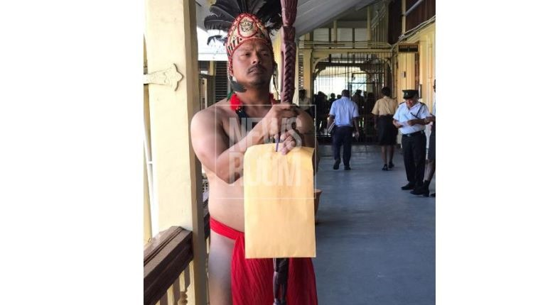 Shuman says it's his constitutional right to dress in indigenous wear