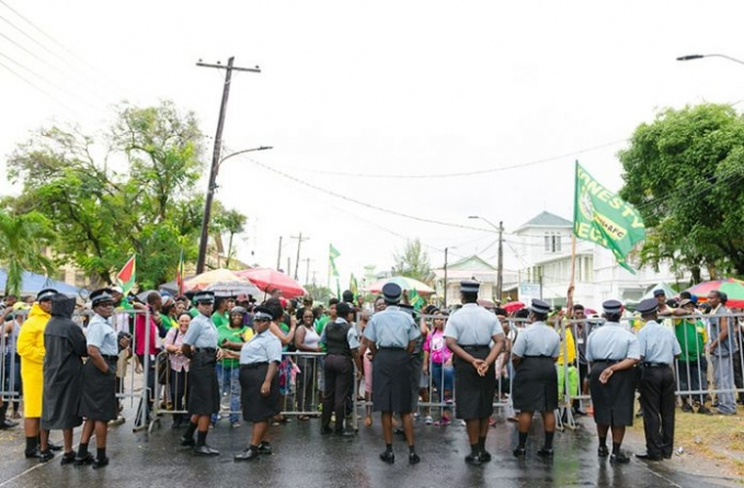 Coalition supporters stand in solidarity with party