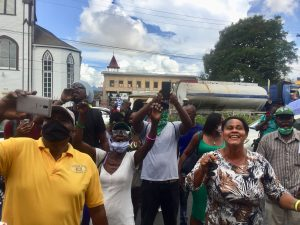APNU+AFC supporters flout Covid-19 restrictions to cheer Lowenfield at court