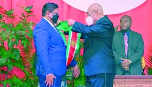Former Suriname President Desi Bouterse (right) peacefully handed over power to President Chan Santokhi less than two months after elections, despite the lure of oil money, a murder conviction and a 20-year jail sentence hanging over his head