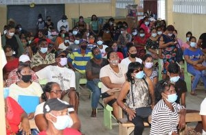 Residents met at the Tuschen Primary School where Housing and Water Minister, Collin Croal, discussed government's plans for development
