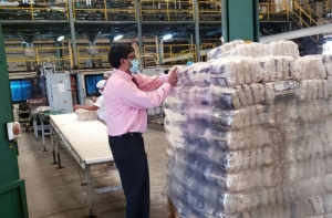 FLASHBACK- GuySuCo's Chief Executive Officer, Sasenarine Singh, assisting in packing the first batch of packaged sugar at the Enmore Packaging Plant