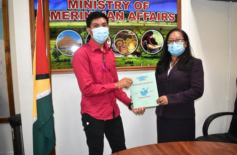 Minister of Amerindian Affairs, Pauline Sukhai with one of the CSOs who successfully completed his training
