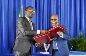 Guyana's Minister of Foreign Affairs and International Cooperation, Hugh Todd and Suriname's Minister of Foreign Affairs, International Business and International Politics, Albert Ramdin, after signing the historic agreement for strategic dialogue and cooperation in neighbouring Suriname on Tuesday