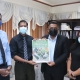 Guyana Chronicle 'Agriculture Supplement' handed over to Minister Mustapha